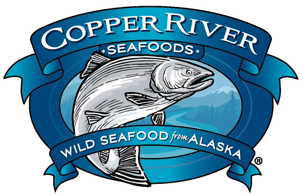 """the Copper River Seafoods logo featuring a drawing of a salmon and the tagline """"Wild Seafood From Alaska"""""""
